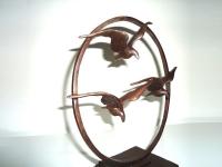 bronzen asbeeld vogels in vlucht